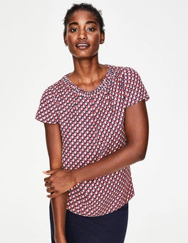 Red Pop Graphic Geo Carey Top