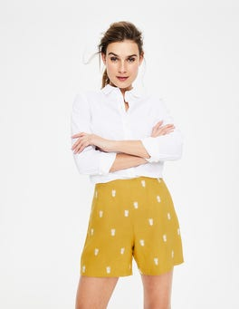 Dijonsenfgelb Shorts mit tropischer Stickerei